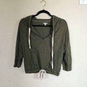 Olive green hooded sweatshirt with cinch waist